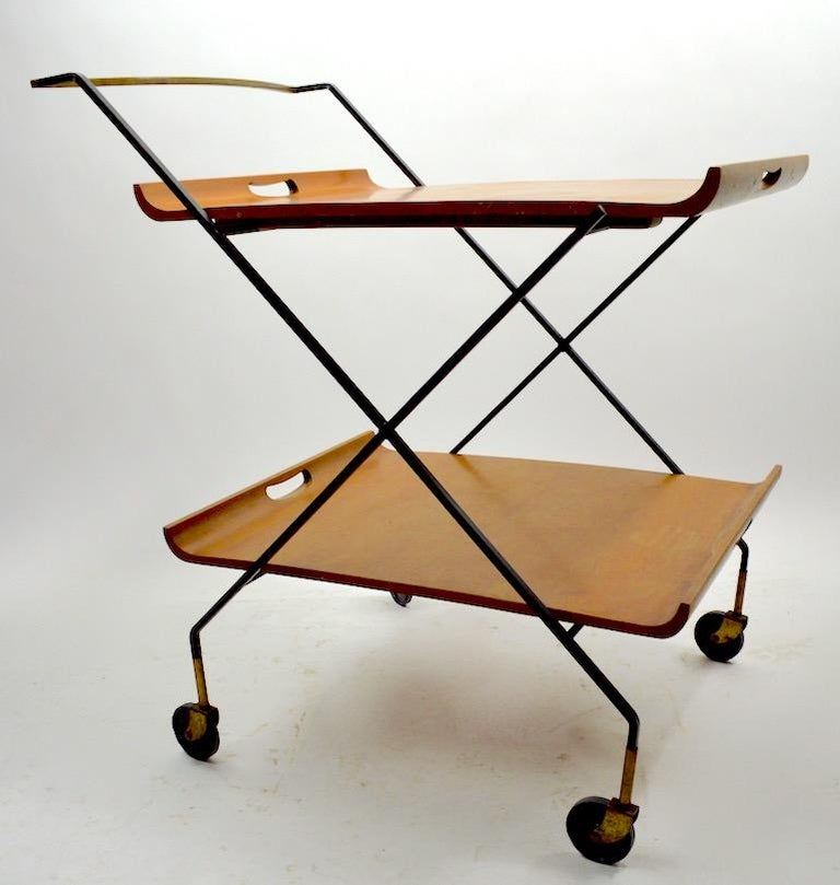 Classic midcentury serving bar cart designed by Milo Baughman for Murrey. This model features two removable serving trays (maple) on squared wrought iron frame with solid brass frame. Each tray 25.5 inch L x 19.75 W Lower tray 11 H Upper tray 27 H.