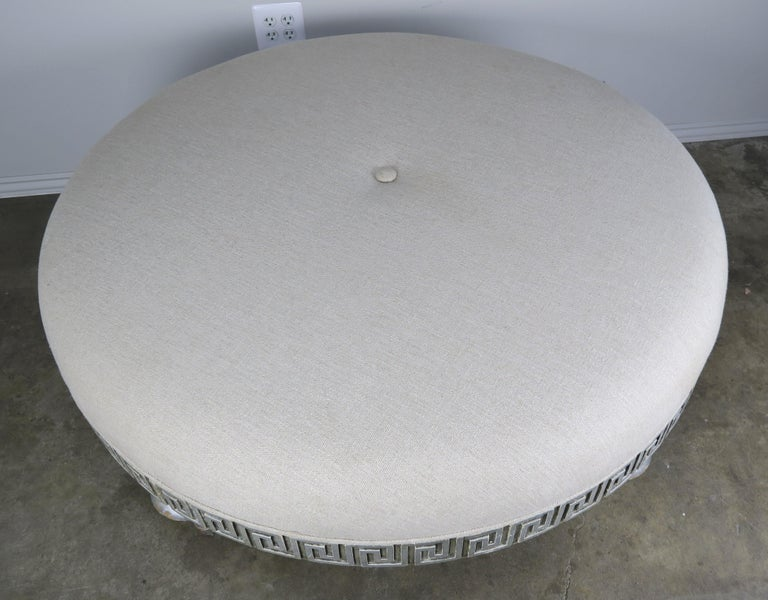 Mid-20th Century Midcentury Carved Greek Key Round Linen Ottoman For Sale
