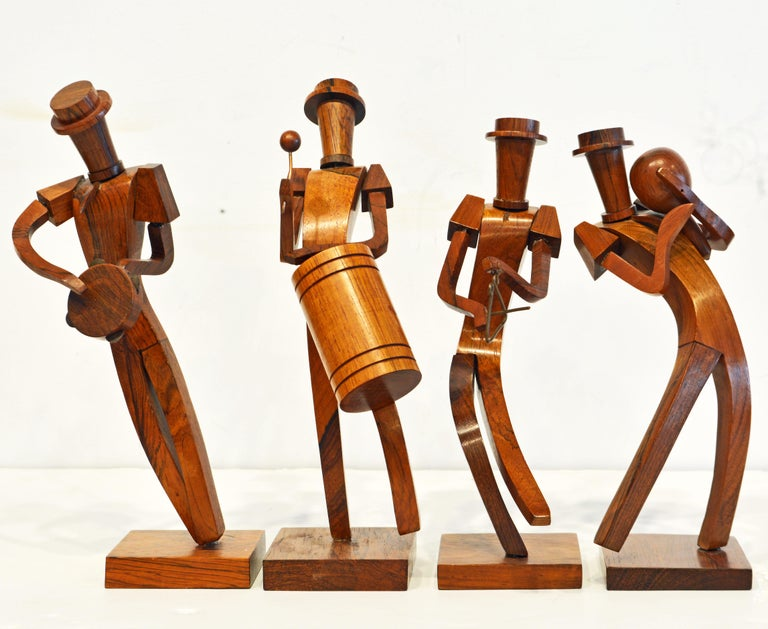 A charming band of four musicians carved in rosewood. Each figure has its own personality expressed in a cubist inspired design.