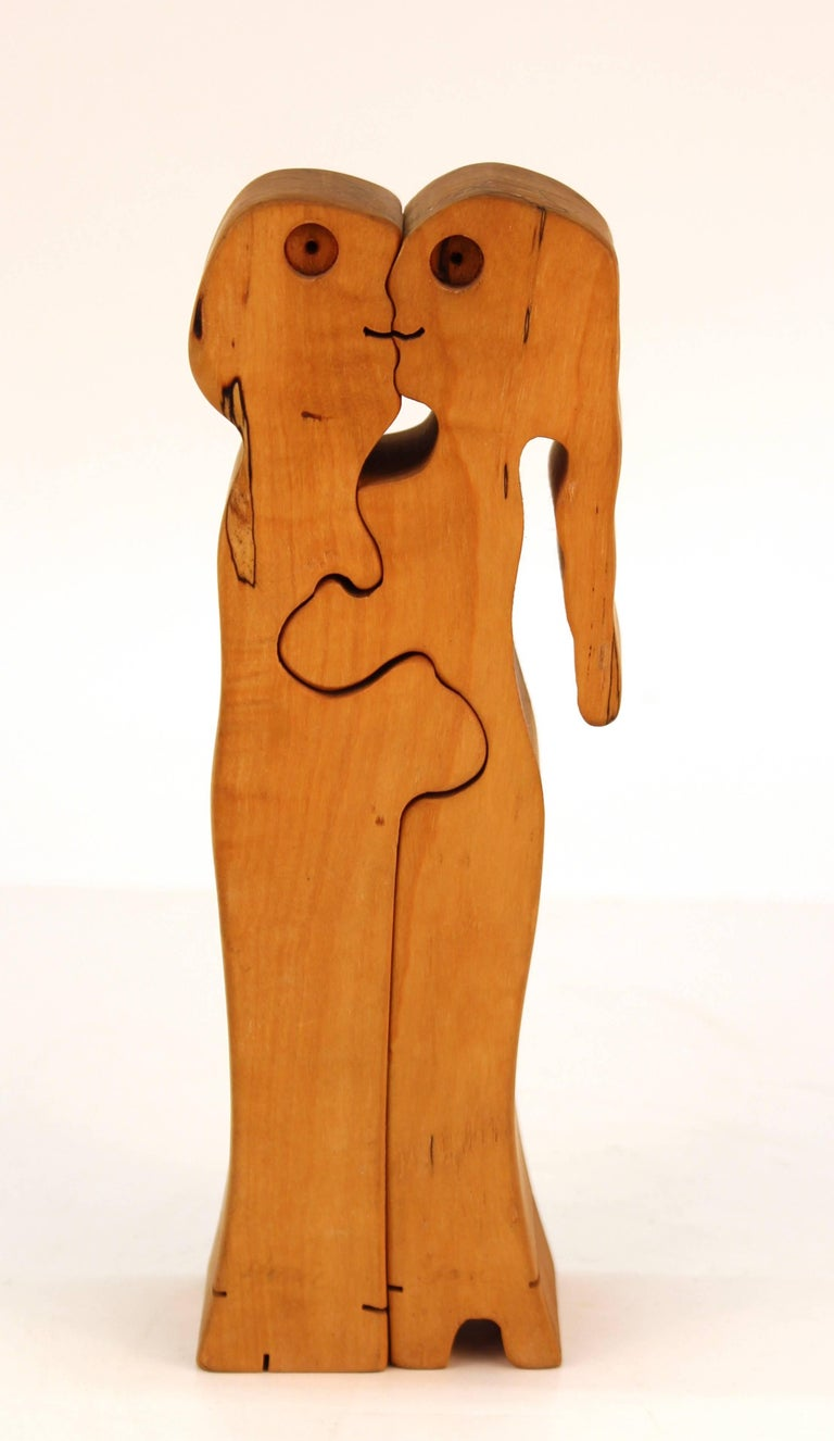 Midcentury carved wood puzzle sculpture of embracing