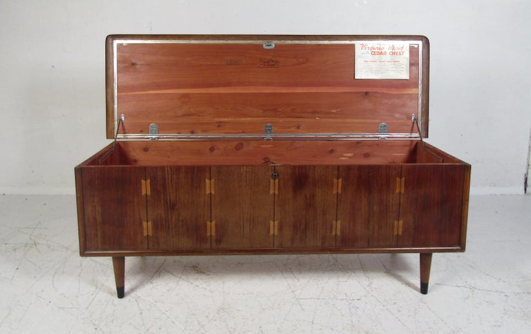 Nice midcentury cedar chest manufactured by Lane in Virginia. Walnut veneer exterior with decorative inlays on the chest's top. Pressure-treated cedar wood sure to keep any precious linens intact. Made in 1965. Please confirm item location with