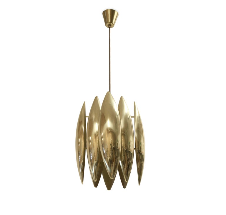 Iconic and decorative ceiling light in brass. This is model 'Kastor', designed by Jo Hammerborg for Fog & Mørup and in production from 1960s second half. The lamp is fully working and in excellent vintage condition.