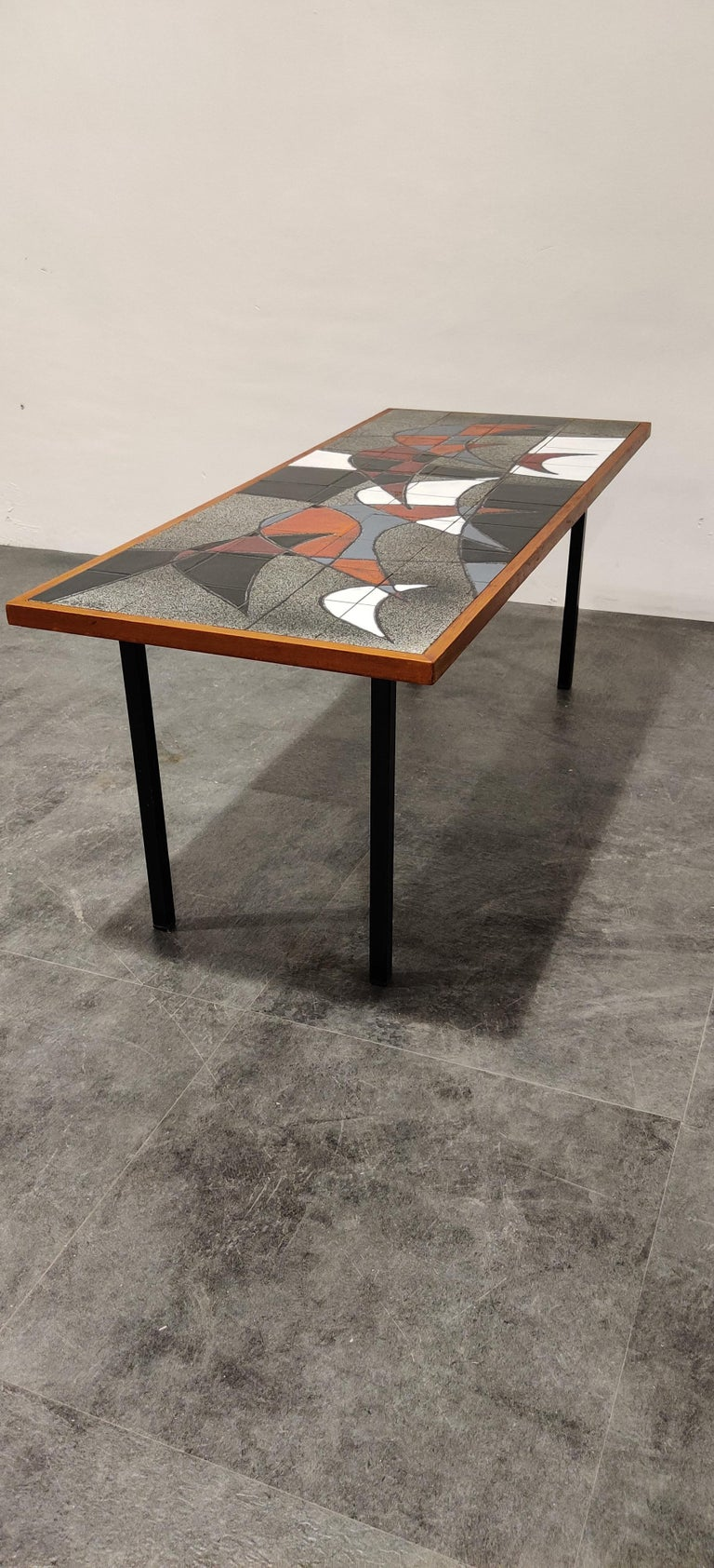 Stricking midcentury coffee table with a ceramic tiled top and a metal frame.  The table is signed by Vigneron.  Attractive colors and design.  Good condition.  1960s, Belgium  Good condition, minimal wear on the