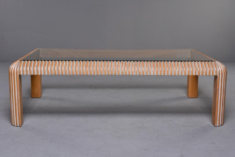 Beveled Mid Century Cerused Coffee Table with Reeded Legs and Glass Top For Sale