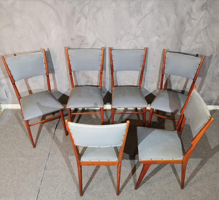 Particular set of 6 midcentury chairs attributed to Carlo de Carli with back and seat covered in sage green leather and wooden structure, 1960s.