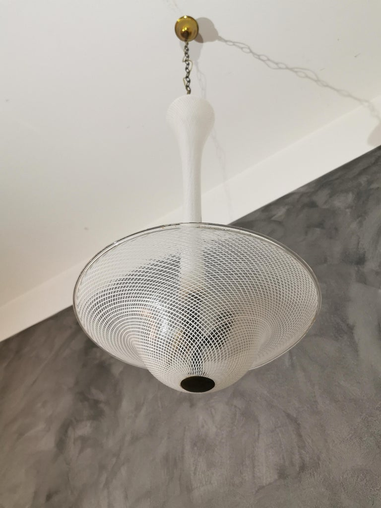 Elegant and rare inverted mushroom-shaped chandelier with brass support and reticello glass by Venini, designed by Carlo Scarpa in the 1940s. The grating is a glass blowing technique used in Italy.
