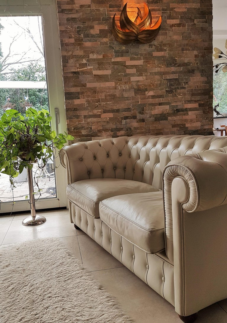 Chesterfield sofa loveseat, white leather, 2 seats. Very good vintage condition. White leather nice patinated, gently worn, no marks or scratches. Coming from fashion showroom, non-smoker!