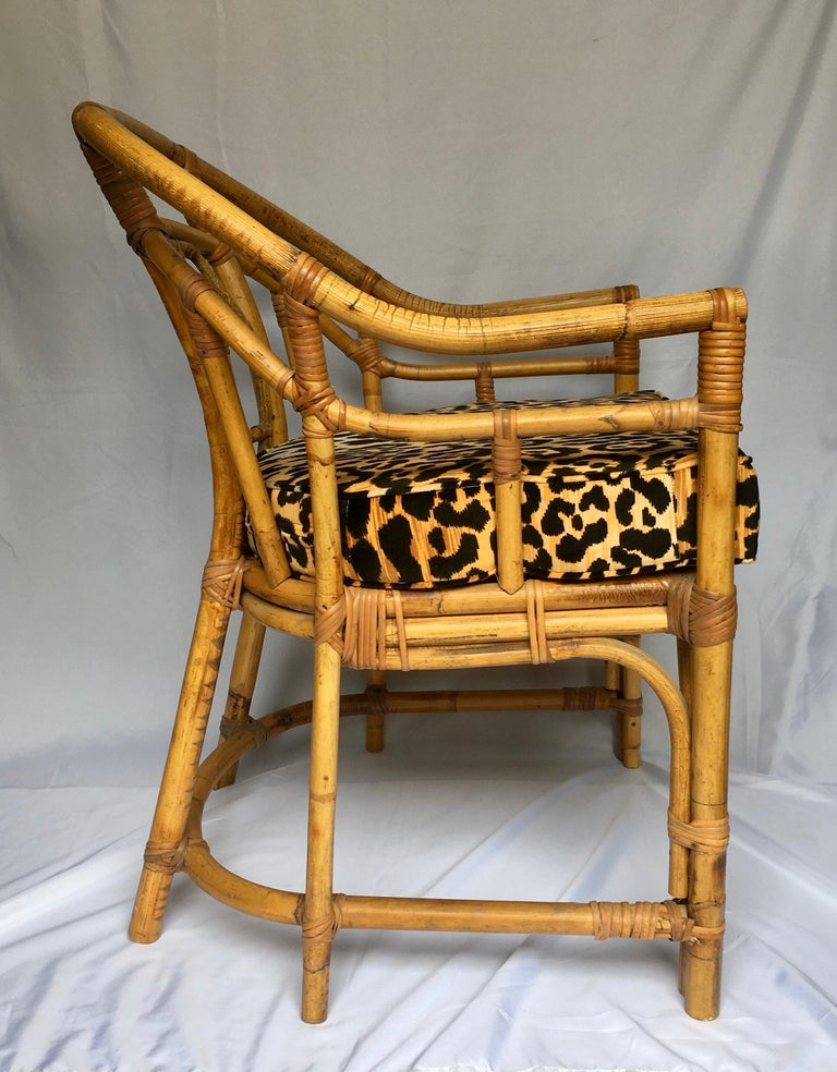 Midcentury Chinese Chippendale Brighton Pavilion style natural bamboo armchair. This chinoiserie style accent arm chair features a geometric fretwork design back and new custom animal print cotton velvet seat cushion. Would also make a beautiful