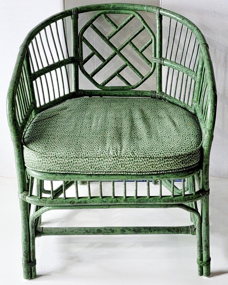 This is a fun chippendale style Brighton bamboo chair in vintage chintz fabric. The frame is a two toned green as is the cushion. It is unmarked.