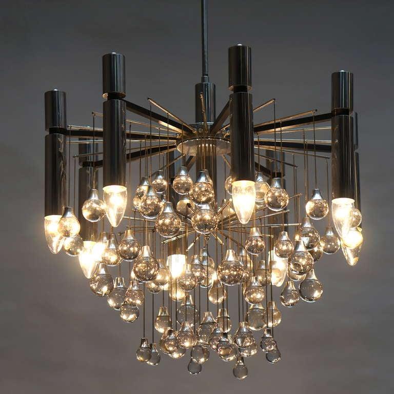 Three Italian chrome and Murano glass chandeliers by Sciolari, 1960s-1970s. Measures: Diameter 55cm. Height 130 cm. Eight E14 bulbs.