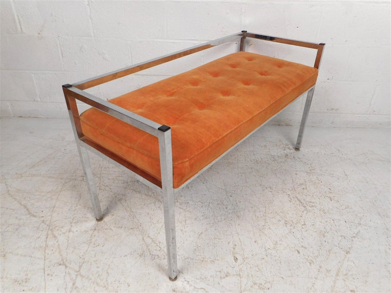 Stylish midcentury settee with a chrome frame. Seat is covered in a vintage tufted orange upholstery. Simplistic yet eye-catching design. Sure to make a great addition to any modern interior. Please confirm item location with dealer (NJ or NY).