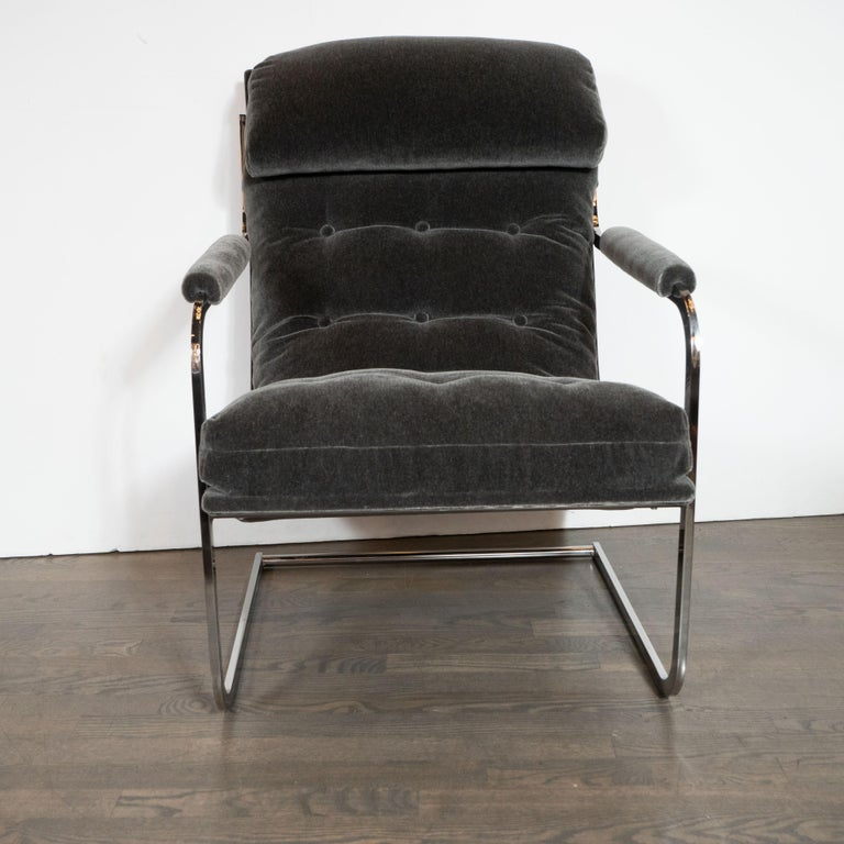 This dramatic and refined pair of Mid-Century Modern chairs were realized by the manufacturer Carsons of High Point in the United States, circa 1970. The feature tubular frames appear forged from a single piece of snaking lustrous chrome, that
