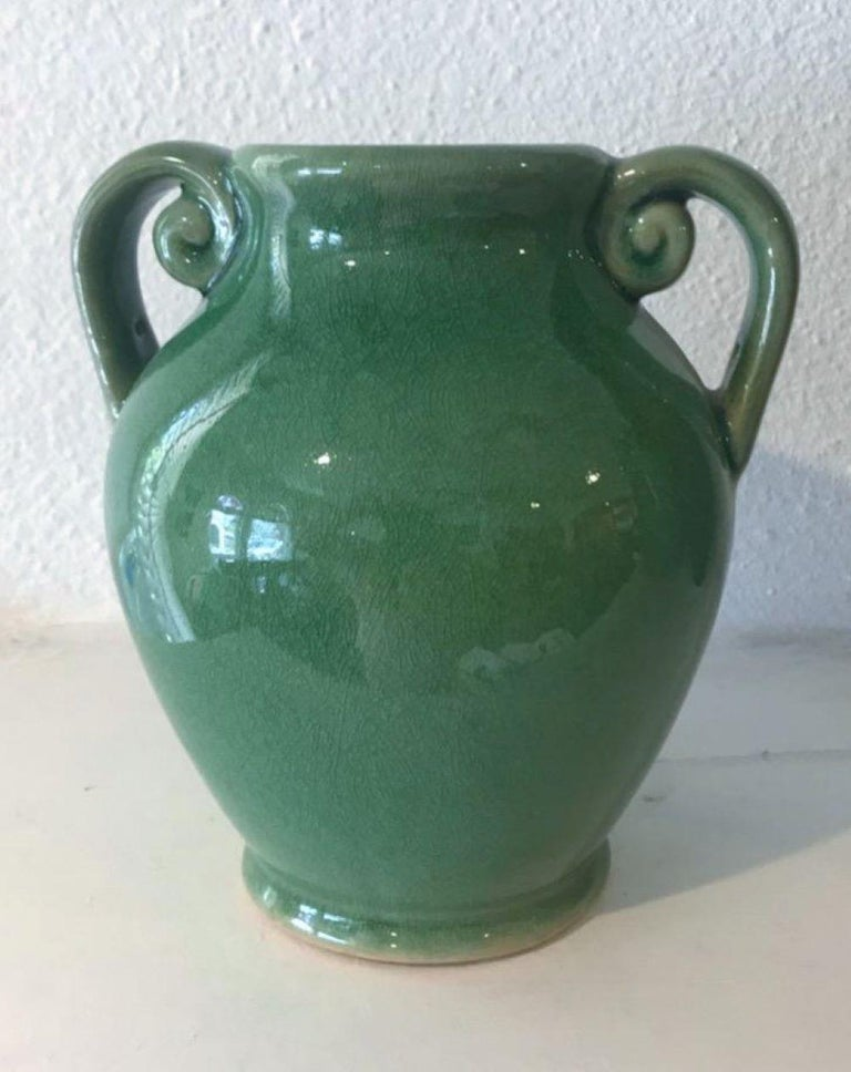 These fantastic green pottery vases are in pristine condition and came from a private collection. Great color and presence.