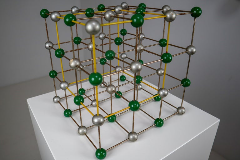 This beautiful patinated metal 1950s molecular structure will display great on any table for presentation. It measures very nicely at 9.75 x 9.75 x 9.75. The piece was used for study in a school in Prague back in the early or late 1950s. It still