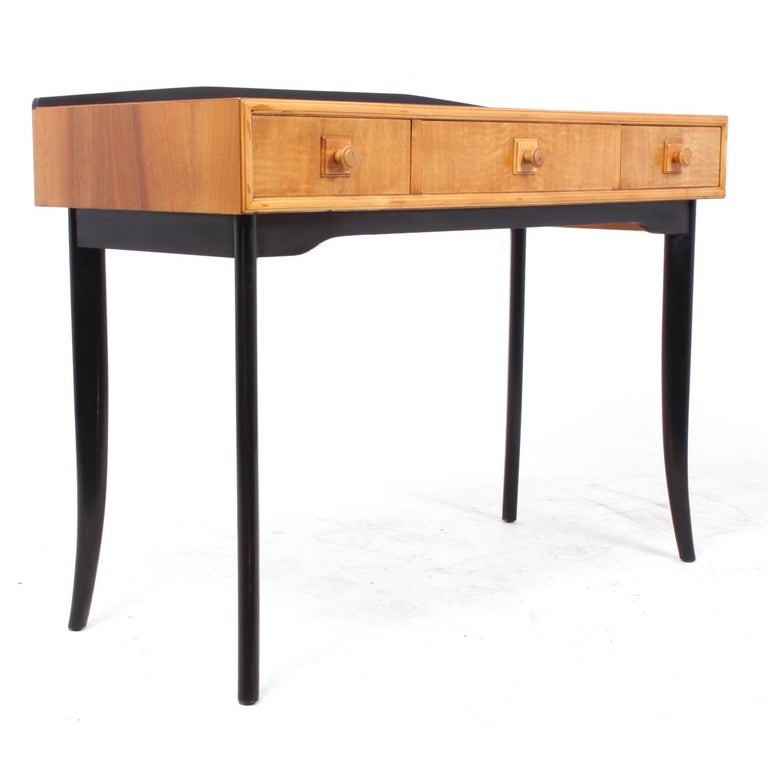 Midcentury console table, circa 1960. A British midcentury console or side table with three drawers in maple with ebonised legs and back up-stand, this is by unknown maker but good quality with dovetail joint construction, the console table has