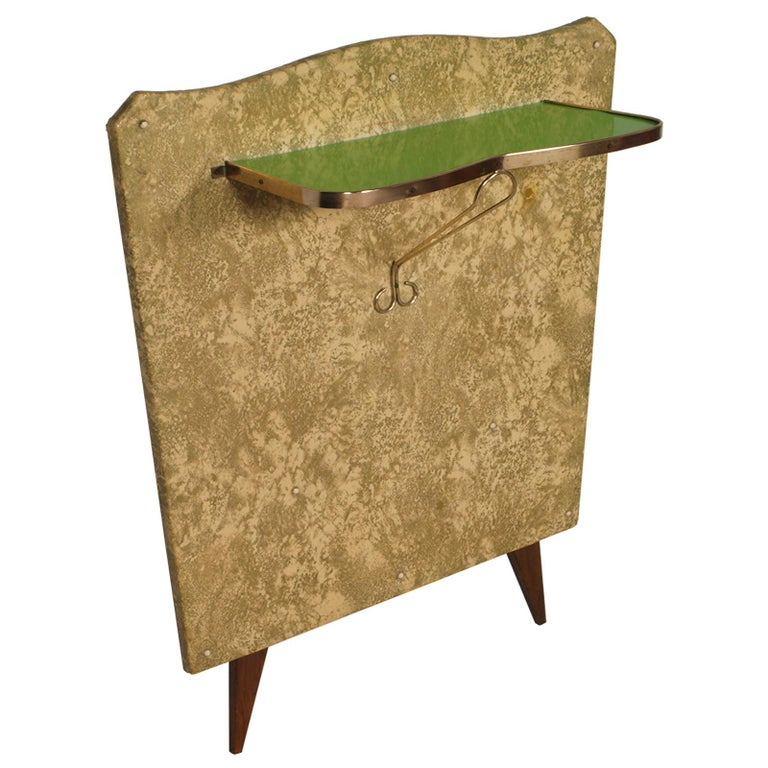1950s console in gilded brass and plasticized fabric by Brugnoli Mobili Cantù, Pier Luigi Colli manner, green lacquered glass top. Simple and elegant essential design.