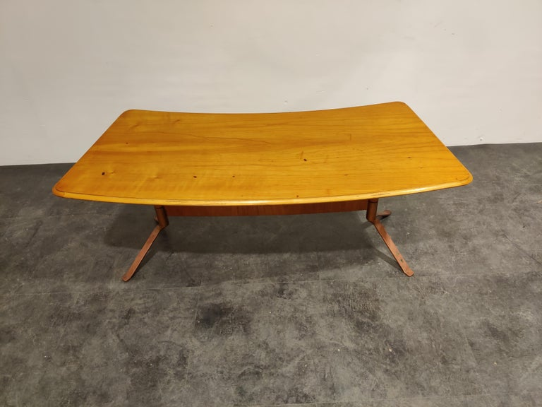 Midcentury curved coffee table made from pine wood and copper legs.