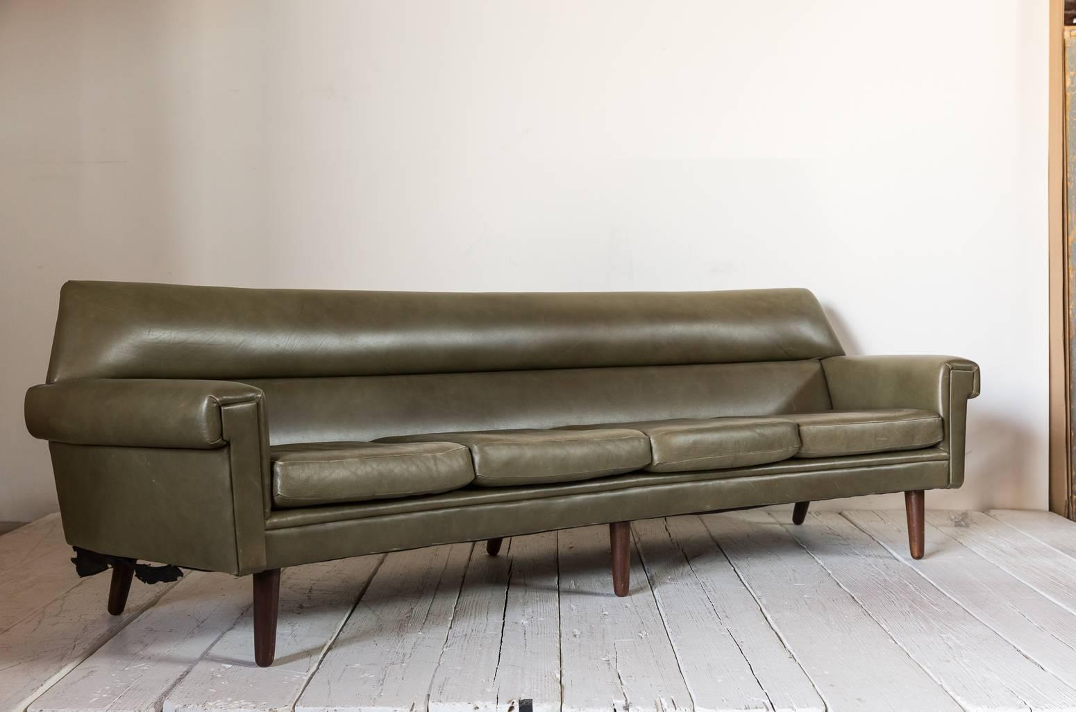 Midcentury Olive Green Leather Sofa With A Slightly Curved Back With A  Tapered Cylindrical Leg And