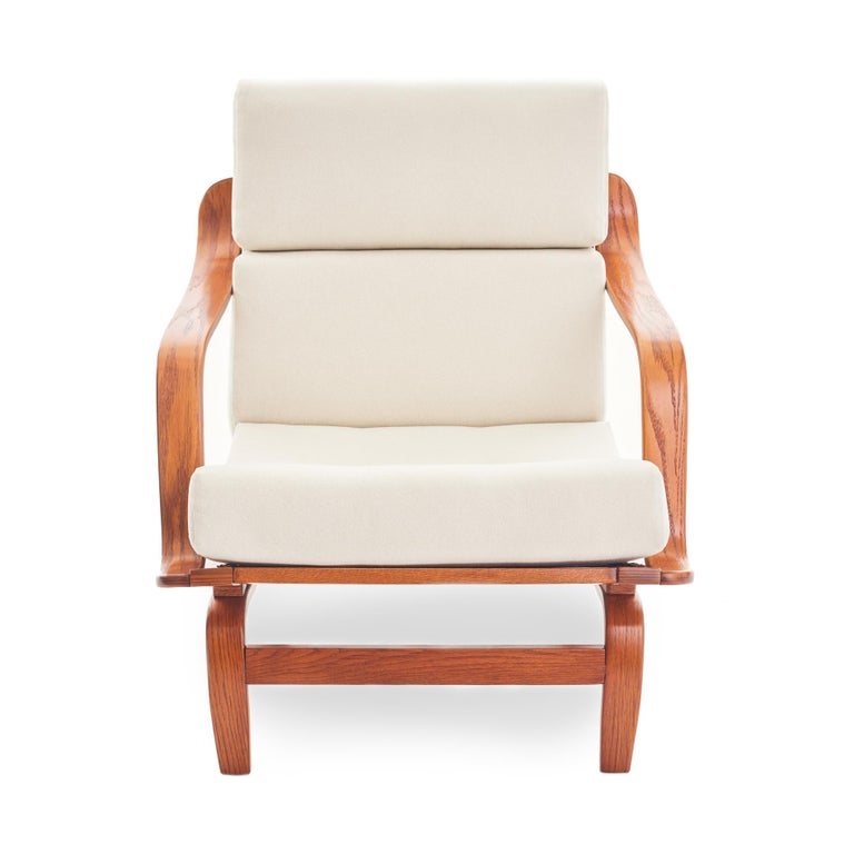 Svelte Danish or Scandinavian style bentwood lounge chair, with curvaceous arms and sculptural legs. Newly upholstered cushions feature a crisp cream flat wool fabric. This chair has been completely refurbished, and all joinery has been cleaned and