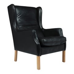 Midcentury Danish Black Leather Wing Chair by Georg Thams