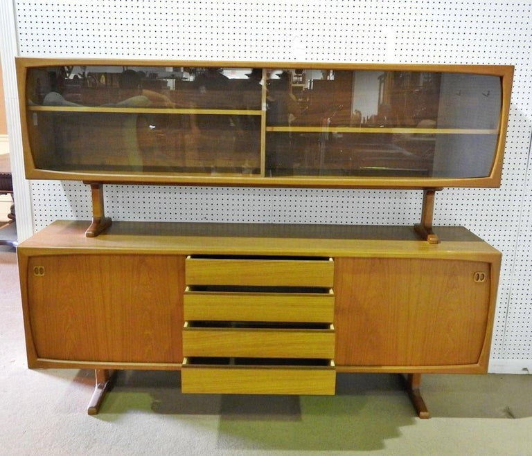 Danish made teak credenza with topper. Two piece unit with ample storage for living or dining room. (Please confirm item location - NY or NJ - with dealer).