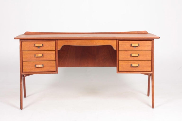 Great looking desk in teak with cane details on the frame and the handles. Designed by Svend Aage Madsen. Made in Denmark in the 1950s. Nice original condition.