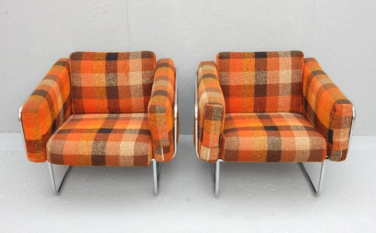 Tubular chrome lounge chairs designed by Hans Eichenberger of Denmark, circa 1960. Gorgeous original fat plaid wool upholstery in bold bright colors. Very comfortable chairs.