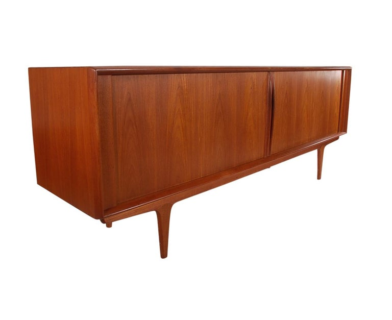 A lovely and long teak credenza produced by Bernhard Pedersen & Son in the 1960s. This cabinet is very clean and has ample storage. Manufactures label. Doors and drawers work as they should. Ready for immediate use.