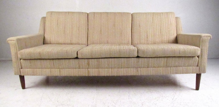 Scandinavian style midcentury three-seat sofa by Dunflex, Denmark. Please confirm item location (NY or NJ) with dealer.