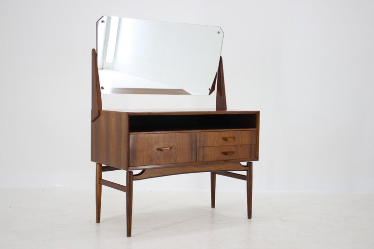- Features mirror, three drawers and shelf - The height to the top desk is 60 cm - This item was carefully refurbished.
