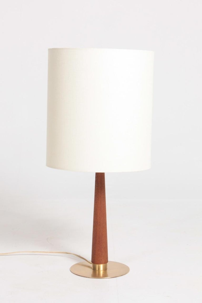 Decorative table lamp in brass designed and made in Denmark. Great original condition.