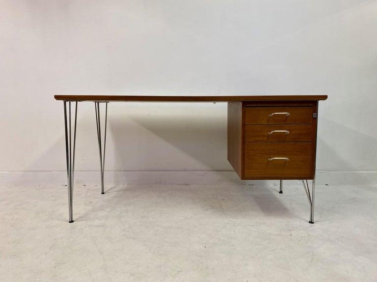 Teak desk  Three drawers  Chrome hairpin legs  Professionally restored  Denmark, 1960s-1970s.