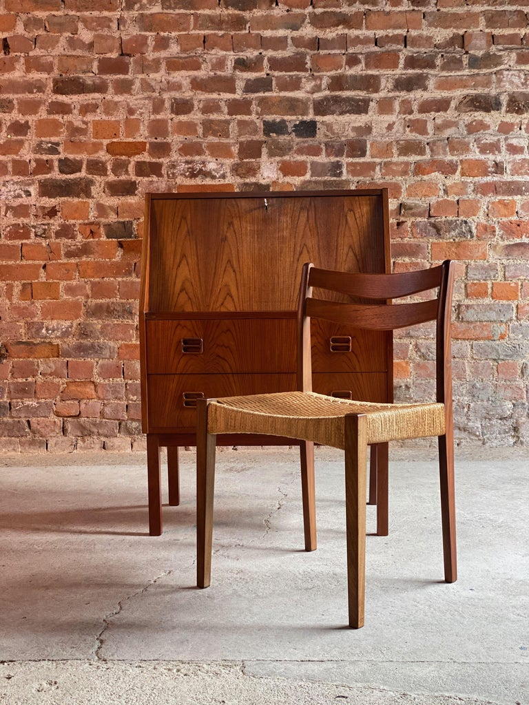 Midcentury Danish teak writing bureau with Moller style chair, Denmark, circa 1970  Fabulous midcentury Danish design writing bureau with matching chair circa Denmark 1970s, the desk with fall flap writing area over two drawers with recessed