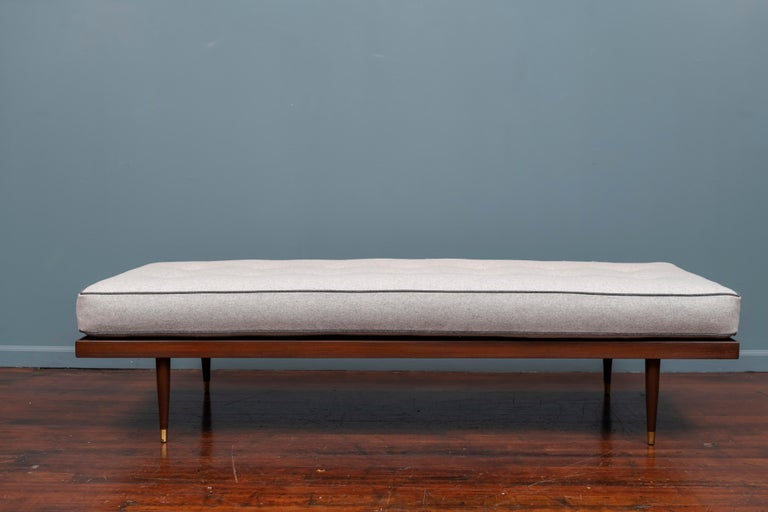 Midcentury daybed newly upholstered in a light gray wool felt on a refinished walnut frame with good spring support, very comfortable.