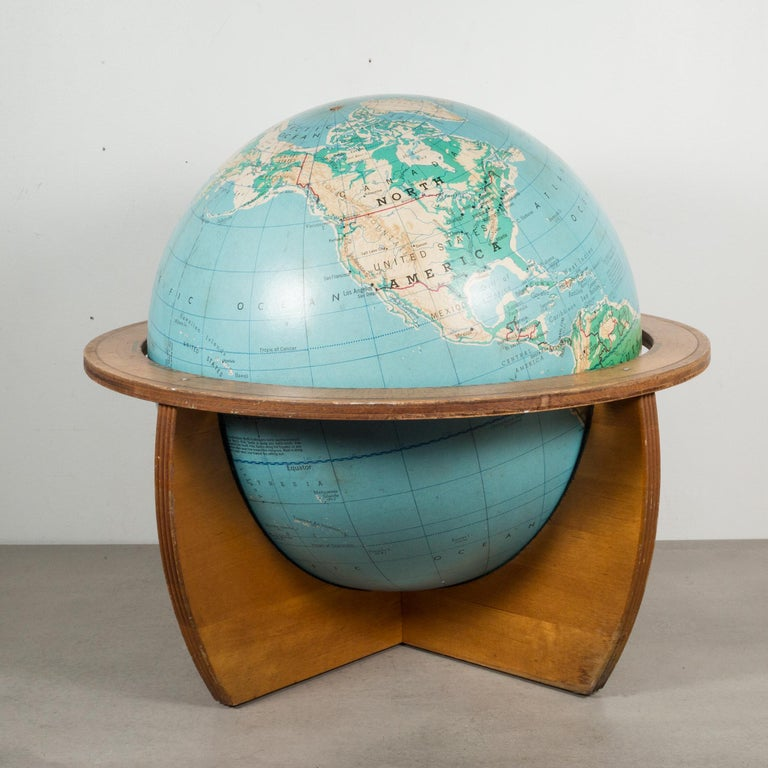 About  This is an original cartocraft physical/political 16 inch globe published by Denoyer-Geppert Company. The globe freely rest on a teak wooden base. The base interior is covered with the original felt which allows the globe to spin easily.