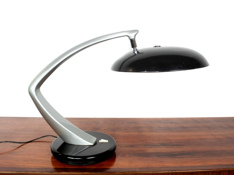 Midcentury desk lamp model 'Boomerang' by Fase from Spain, 1960s. This lamp is has a grey body and black hood, both in metal. The table lamp is 360 degrees turnable, which is very practical. It has a white diffuser, which is in good condition