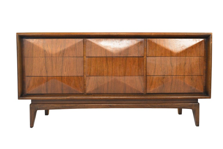 This low midcentury dresser was designed by United in the 1960s. Drawers feature a three- dimensional sculpted diamond design. In excellent original condition.