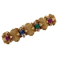 Mid-Century Diamond Ruby Emerald Sapphire Ribbed 14K Yellow Gold Bracelet