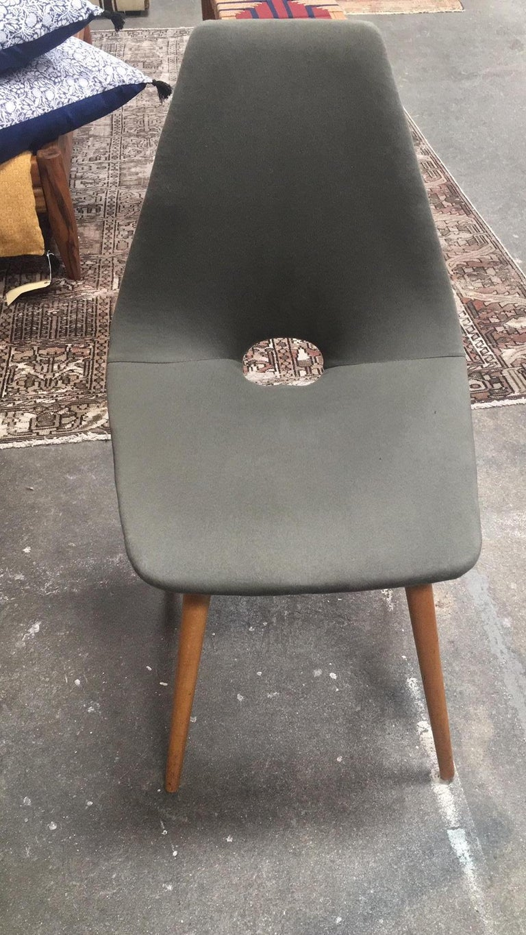 A set of 4 reupholstered midcentury dining chairs.