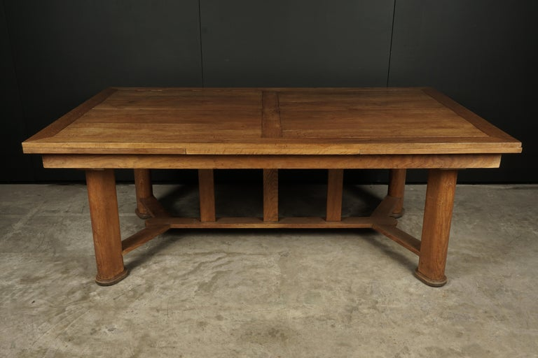 Midcentury dining table from France, circa 1950. Heavy construction in oak with nice details. Two leaves store under the top can be easily extended. Width of leaves are 25.5 each.