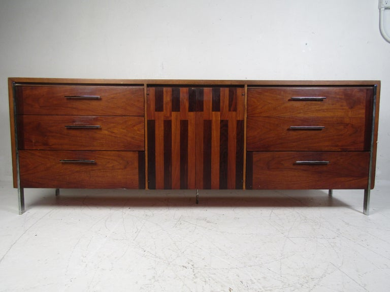Mid-Century Modern dresser manufactured by Lane. Interesting design with inlays scattered across the drawer-fronts. Chrome drawer pulls and legs. Please confirm item location with dealer (NJ or NY).