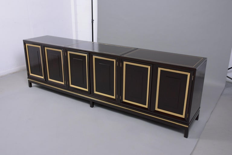 This vintage mid century three-piece ebonized credenza is in great condition and has been professionally restored. This buffet has been newly stained in a rich ebonized color with gilt details and has been sealed with a clear lacquered finish. The