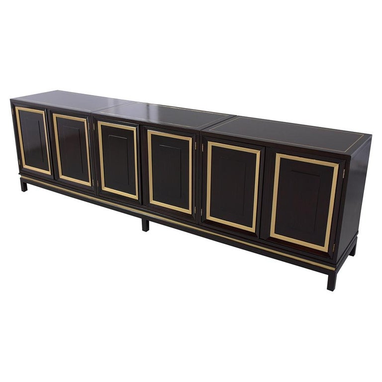 This vintage mid-century three-piece ebonized credenza is in great condition and has been professionally restored. This buffet has been newly stained in a rich ebonized color with gilt details and has been sealed with a clear lacquered finish. The