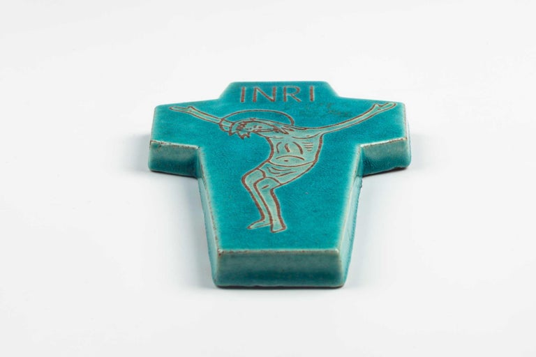 Midcentury ceramic European wall cross with line drawn christ figure in graceful pose. hand painted in teal blue and white, and christ figure in natural red clay. Beautiful crackled glaze adds depth. From a large collection of vintage crosses