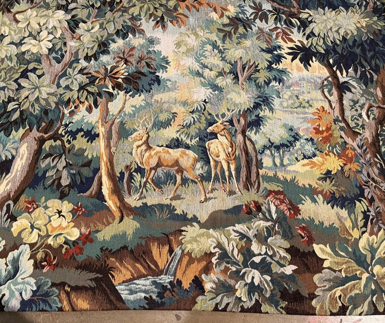 Decorate a ranch or a hunting lodge with this colorful verdure tapestry. Hand woven with machine help in Belgian circa 1960 and titled