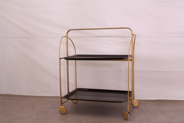 Folding bar cart drinks trolley midcentury circa 1960s This serving trolley can also be used as a side table, when half folded. In good working order Very versatile and practical In good vintage condition with only minor signs of use.