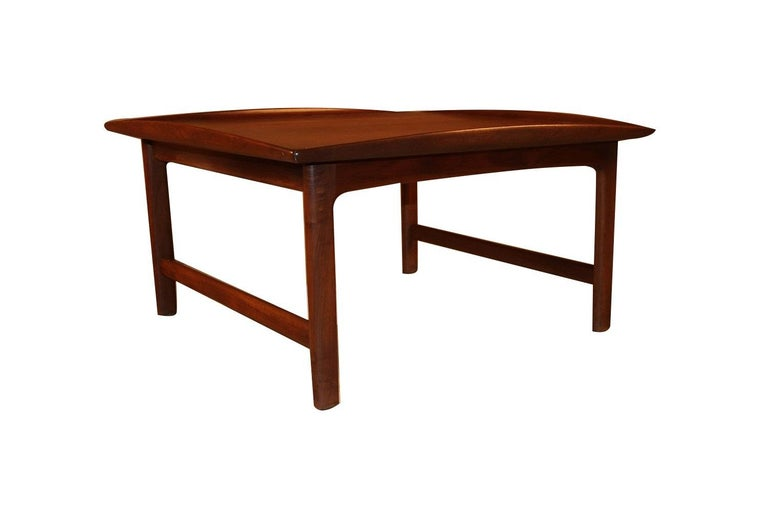 A wonderful turned edge teak coffee table designed by Folke Ohlsson, made by Dux in Sweden. Features a gorgeous wood grain, manufacturer's name stamped on the underside DUX. This table is exemplary of Danish Modern, Eames era elegance, gorgeous