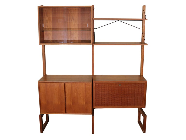 This is a 1960s free standing teak shelving system or wall unit by Paul Cadovius.
