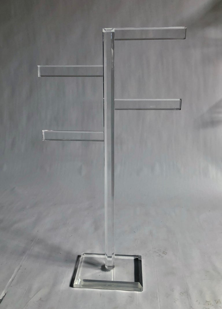 1970s thick Lucite freestanding rack in the style of Charles Hollis Jones. Can be used for towels, coats, apparel, magazines, etc.