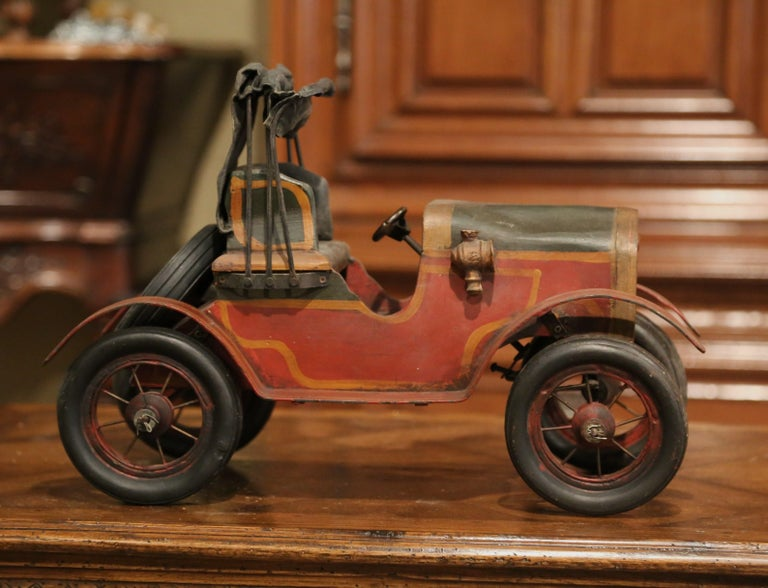 Decorate a man's office or a little boy's room with this vintage model car. Crafted in France, circa 1970, the Classic, miniature car stands on rubber tires with a spare wheel attached on the back. The piece is a must-have for the car collector. The